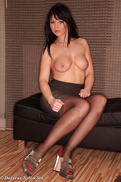 Topless Euro woman Desyra Noir posing all round skirt and stockings