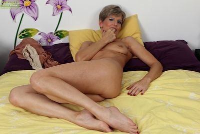Gorgeous mature babe Melanie is being filmed at near revile