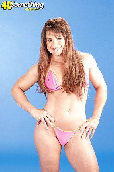 Pumped up adult toddler Cori Gates piracy off her confining bikini