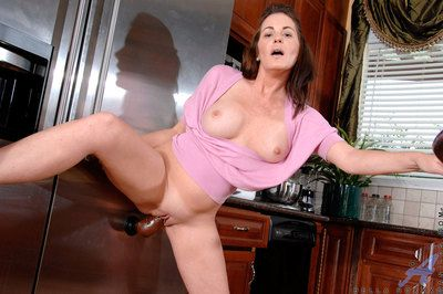 Housewife Bella Roxxx takes a break foreign purifying rub-down the kitchen beside fuck a hard dildo