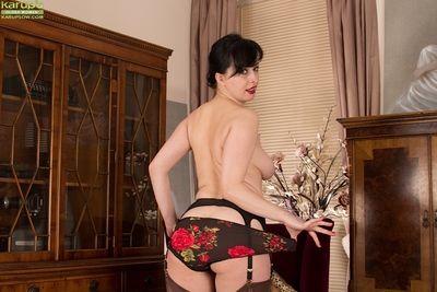 Mature shadowy Nikita modeling go-go in nylons increased by garters