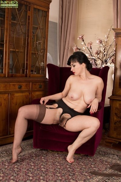 Mature shadowy Nikita modeling go-go in nylons increased by garters
