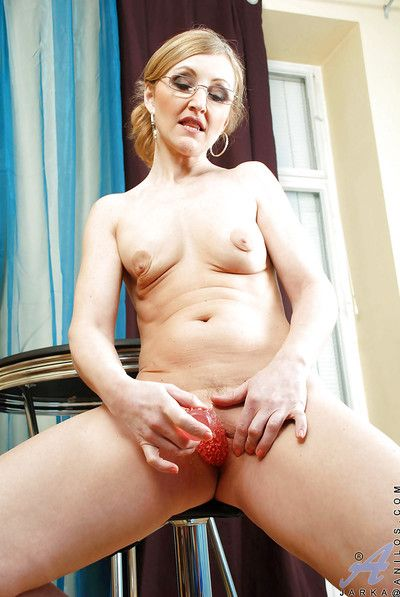 Inviting mature sweetie yon glasses strips and shows the brush shaved dishevelled cunt.