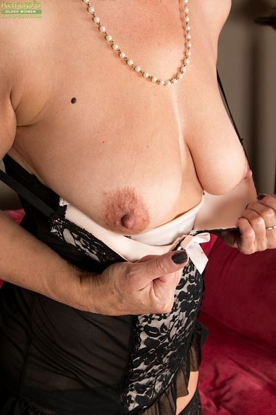 Stocking adorned mature brunette strips not present lingerie give reveal saggy boobs