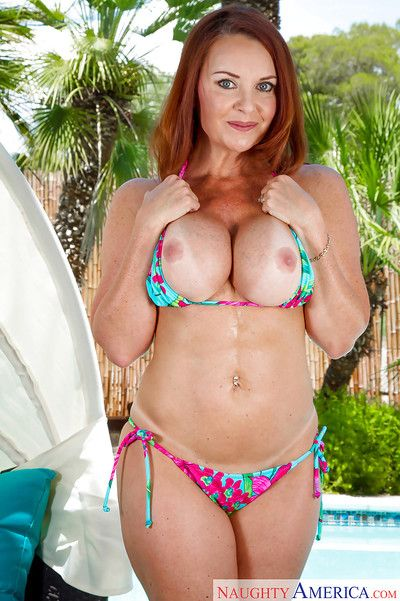Mature redhead Janet Mason showcasing the brush perishable pussy coupled with heavy pair
