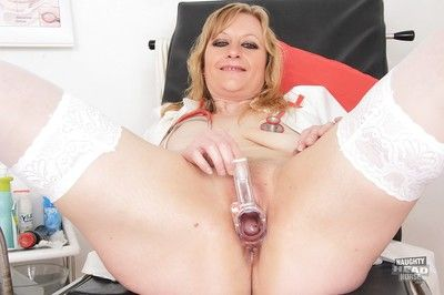 Nurse Susan Blue-eyed fucks her tight left-wing hole with some instruments