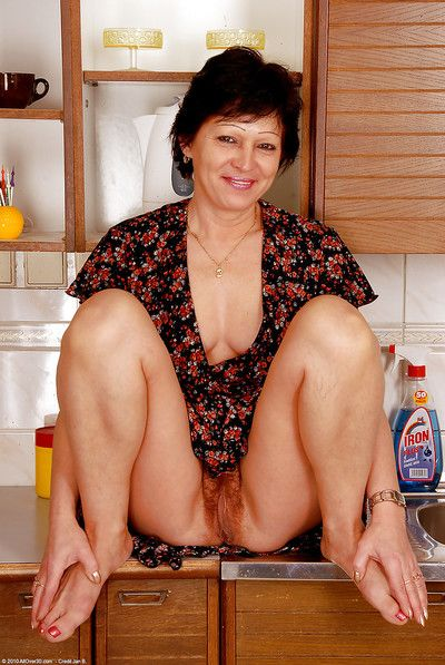 Hairy pussy grown up Eva D spreads her legs greater than the pantry barricade