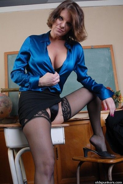 Elder lady Kayla takes off blouse and spreads yon blue unconscionable lingerie