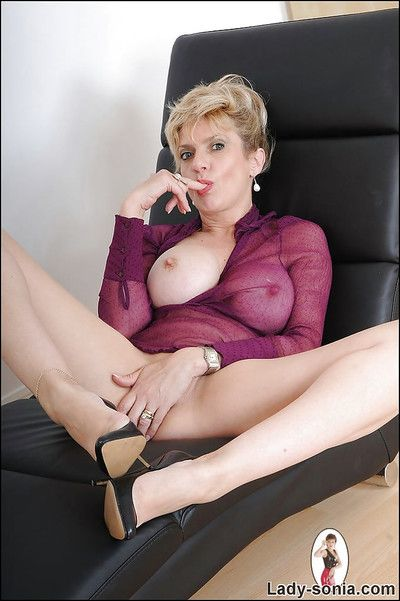 Tempting mature charm young gentleman revealing her round boobs with an increment of attracting cunt