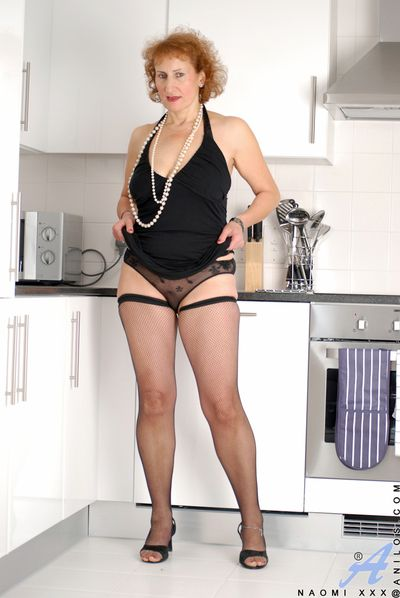 Licentious Naomi XXX posing close to only stockings and heels