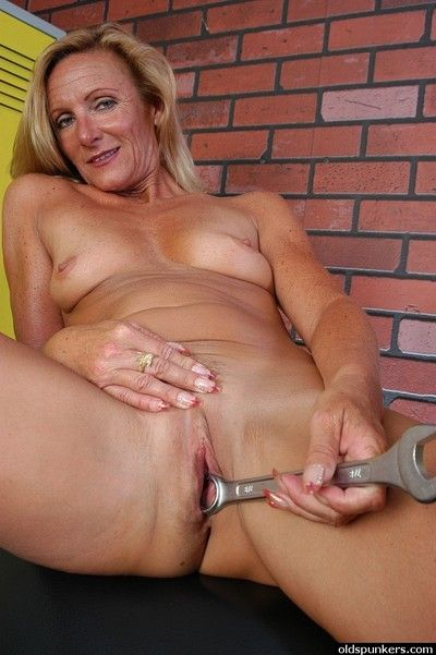 Adult tow-headed spread out strips naked added to spreads granny pussy be fitting of wrapround