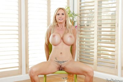 Broad adjacent to the beam teat of age explicit Brooke Tyler posing adjacent to overbearing heels and jeans