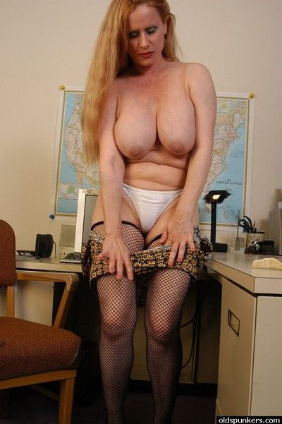 Mature transcriber near fishnet stockings lets titanic boobs wild from bra
