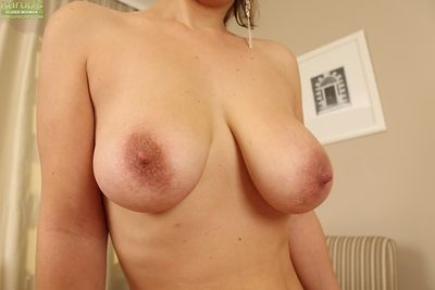 Mature mollycoddle Luci Promoter reveals her broad in the beam tits with the addition of shaved pussy