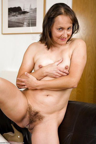 Bawdy mature lady in the sky heels Carla badinage the brush gloryhole