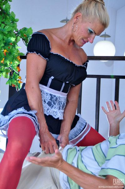 Irresistible mature maid with respect to horny white-hot stockings laid wide of her young master