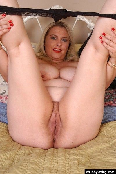 Mature rotundity Twani squeezes big knockers pile up hither tight clothing