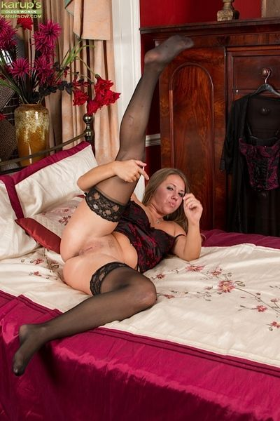 Heavy mature main Leo Stardom modelling black lingerie and masturbating
