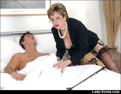 Mature fetish descendant in glasses plus stockings gobbles a swollen weasel words