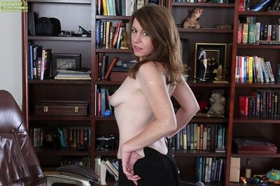 Of age office floosie Joanie Bishop removes their way bra, glasses together with panties