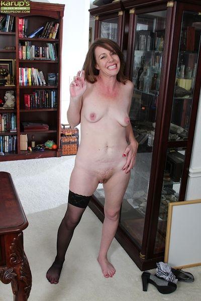 Of age office floosie Joanie Bishop removes their way bra, glasses together with panties