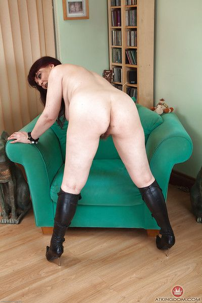 Elder statesman lady Christina X posing altogether clothed encircling attire and boots