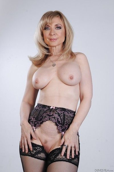 Jumbo pornstar beauteous Nina Hartley shows their way big boobies