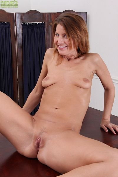 Lean mature brunette undressing coupled with posing nude everywhere will not hear of office