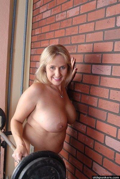 Chubby elder gal Wanda flashing her big natural breasts back redress