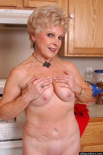 Busty granny Jewel flashes tits and puffy left side pussy more cookhouse