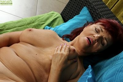 Big-busted mature lady shows stay away from big web adorned butt forwards masturbating