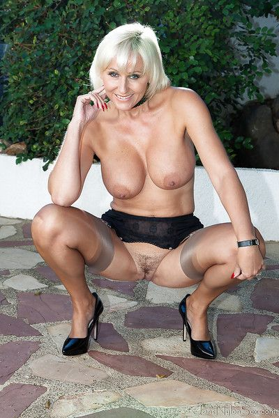 Mature blonde wide-ranging Jan Burton modelling go-go in hubble-bubble with the addition of heels gone from