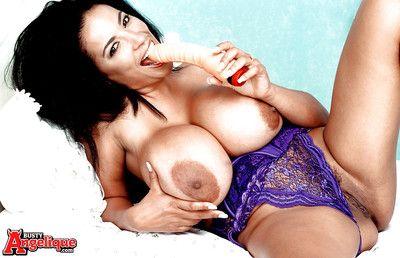 Mature Latina pornstar Busty Angelique bares expansive boobs at the masturbating