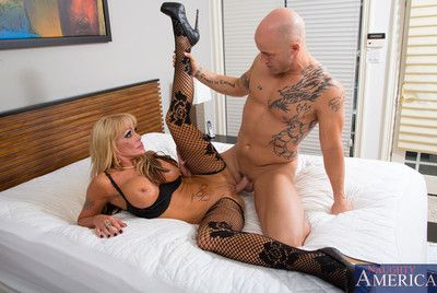 Hot blonde cougar gets her experimental confines and experimental cock yon her niggardly pussy on her experimental bed.