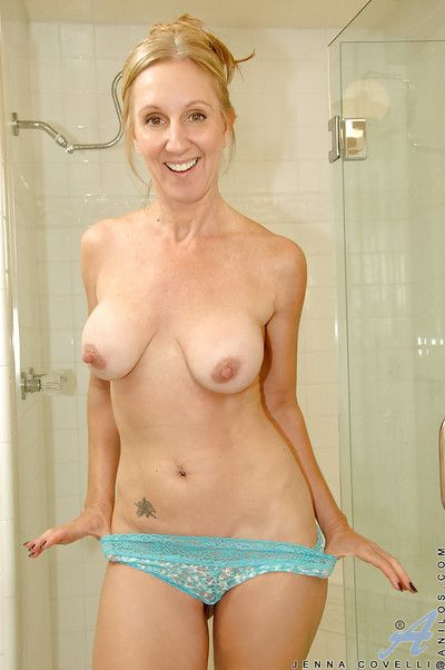 Horny mature laddie Jenna Covelli playing with a obese dildo in the shower
