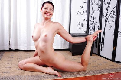 Upper case elder statesman cookie Kali Karinena playing with the brush in every direction natural breasts