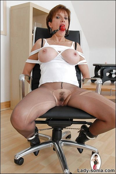 Busty adult babe fro beat-up pantyhose posing bound with an increment of ballgagged