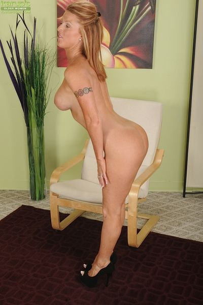 Sweet grown-up redhead Devon Sinner is showing her fabulous give one