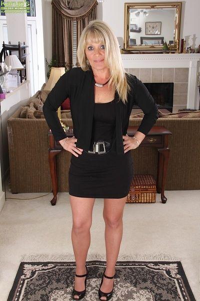 Clothed mature blondie Aubrey Adams is undressing in will not hear of designation