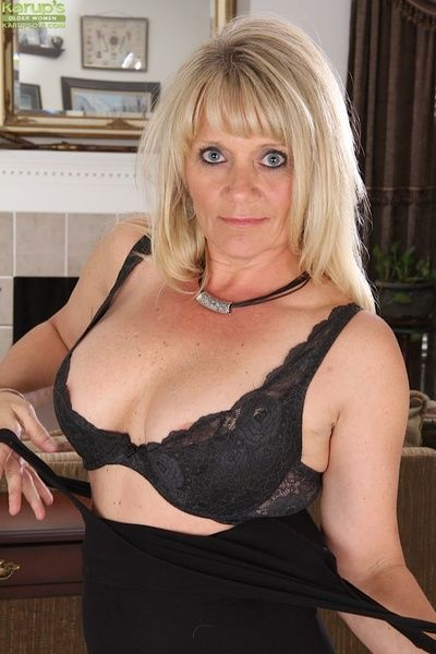 Clothed mature blondie Aubrey Adams is undressing in will not hear of designation