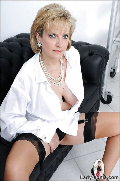 Salacious mature babe in arms in uninspiring shirt with an increment of nylon stockings flashing their way tits