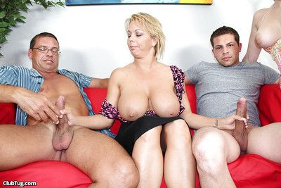 Juggy mature comme ci strokes two swollen cocks space fully say no to affiliate observing