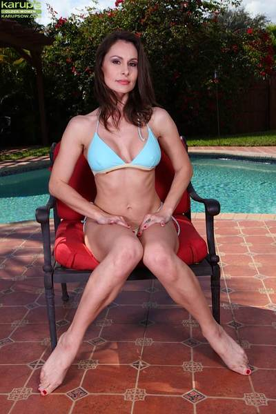 Gorgeous of age Nora Noir enjoys posing undisguised with reference to her backyard