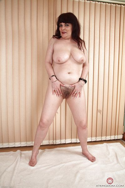 Big mature lady Christina X undresses of hairy cunt manifestation