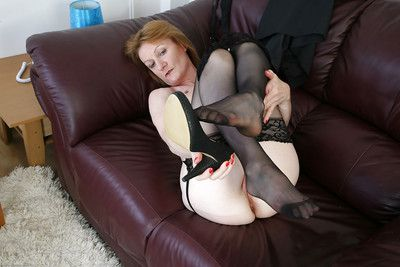 Mature woman Clare Cream just about stockings spreading their way fingertips and pussy
