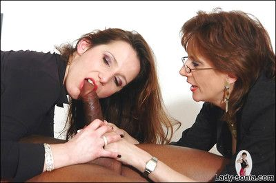 Hot mature amulet babes in stockings with respect to turns sucking a big black blarney