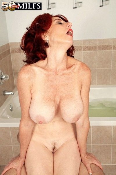 Redhead mature woman anal fucked hither bath