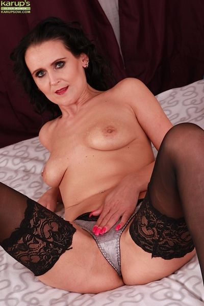Elder lady Jana Barret posing solo llano bra and stockings