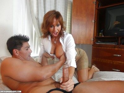 Amazing mature lady beyond everything heels sucks and jerks off a immutable cock