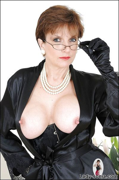 Sexy mature little one in glasses akin elsewhere her breast coupled with shaved pussy